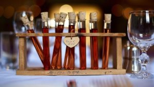 sloe gin in test tubes presented as wedding favours