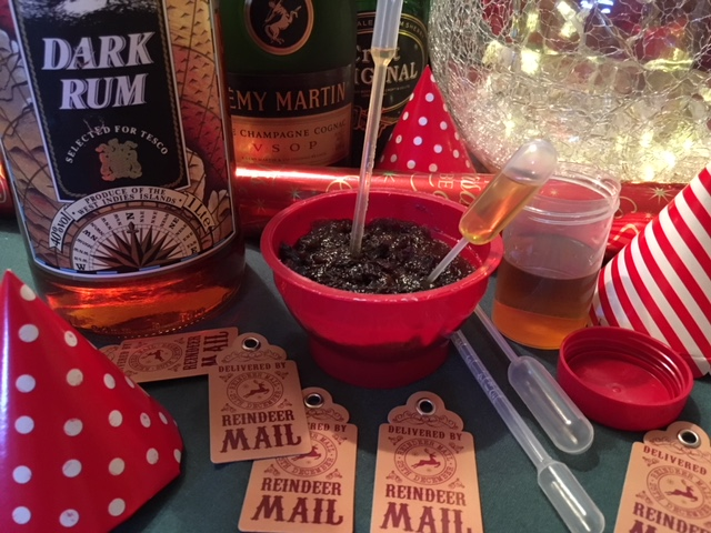 Christmas pudding with tipple bottles & pipettes